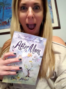 "Author Diane Michael poses excitedly with a copy of her book, ""After Mom"""