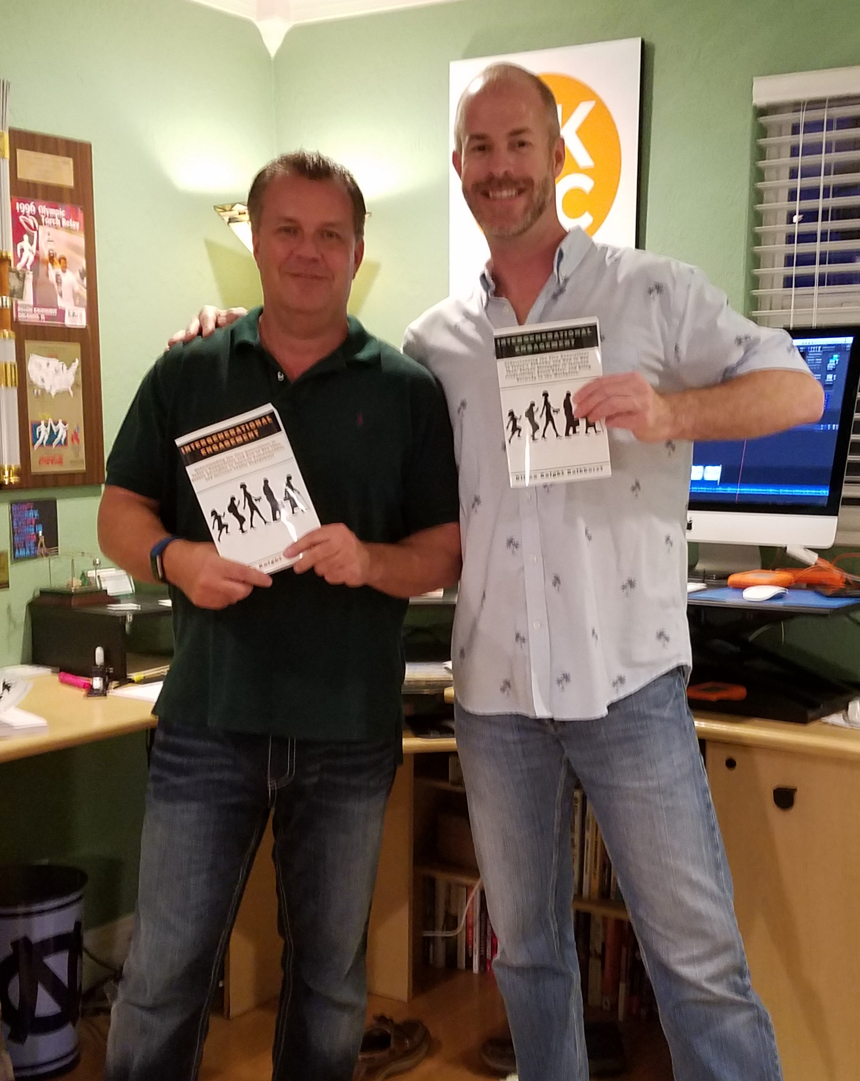"Dillon Knight Kalkhurst and Sean Donovan pose with copies of Dillon's book ""Intergenerational Engagement"""