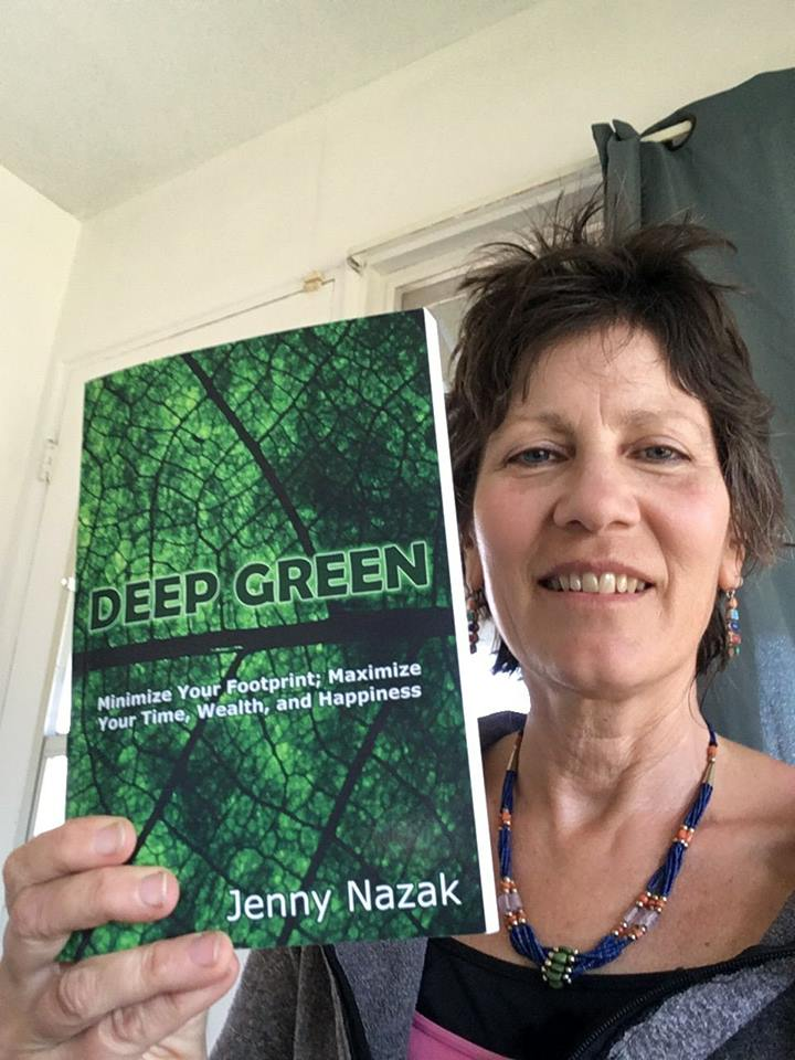 Author Jenny Nazak poses with a copy of her book, Deep Green