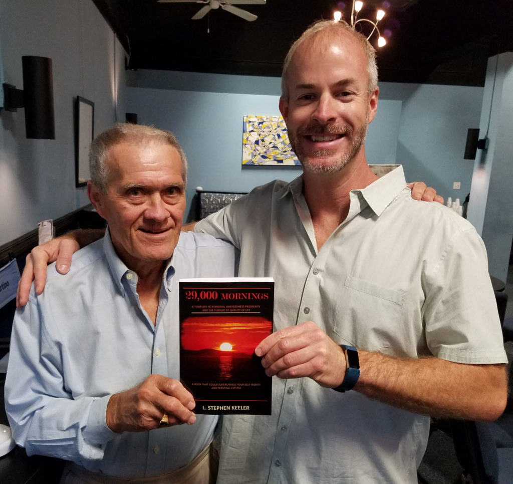 "Steve Keeler and Sean Donovan pose together with Steve's book, ""29,000 Mornings"""